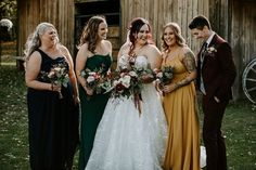 We loved this rich color palette for a fall wedding at the Red Tin Barn. These mismatched bridesmaid dresses compliment the fall colors at the Red Tin Barn wedding venue in Edmonton. Theatre Wedding, Barn Wedding Venue, Wedding Couples, Wedding Photos, Party Photos, Wedding Ideas, Mismatched Bridesmaid Dresses, Davids Bridal, Designer Wedding Dresses