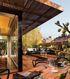 """""""I clad the roof in reclaimed Philippine mahogany to give it warmth,"""" says Aharoni. """"The brise-soleil, designed from the same wood, tempers the light entering the interior space.""""  Photo: Paul Warchol"""