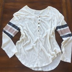 Free People baseball style tee. M Cute free people baseball style tshirt   It's a medium but runs a little big. Half button in front with seam detailing on front and back with stripes on arms. Worn a few times. In great shape! Cute for a casual day with jeans or leggings Free People Tops Tees - Long Sleeve