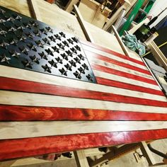 Rustic flag made out of 1x4's and 1x6's. Water based stains and iron stars that have a built in brad nail.  Burned slightly and coated in semi gloss lacquer.