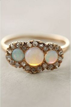 diamond and opal anthro ring -- looks like its catching the sun set. I would probably die. My favorite time of day is dusk.