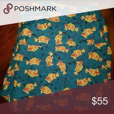 Goldfish lularoe leggings Blue background with goldfish lularoe leggings tall and curvy new never worn with tags LuLaRoe Pants Leggings