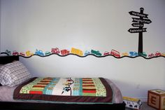 Road sign with vehicles and road vinyl wall by CreationsbyHeidiLLC, $45.00. I think I love this.