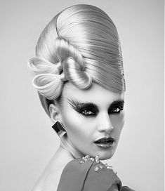 A long blonde straight coloured sculptured avant-garde beehive hairstyle by Anne Veck Hair
