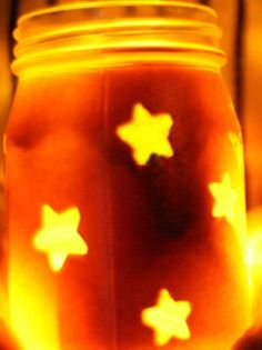 put star stickers on the outside and then paint the jar and take off the star stickers!! So cute!!