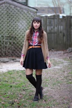 Classic combinations and silhouettes are evermore appealing to me as of late and, in this instance, I just love how unexpected details such as the knotted belt, A-line skirt, and knee-high socks elevate this look to one that's incredibly chic.