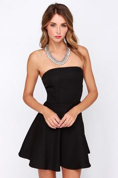 Sway, shimmy, and shake the night away in the Dancing Darling Black Strapless Dress!