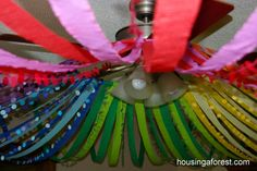 Color Wheel Ceiling  Attach streamers to a hula hoop and hang