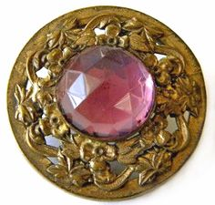 Gay 90's gilt brass button with openwork and faceted pink glass stone.