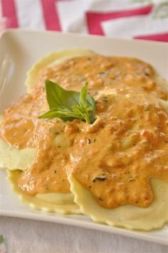 """Spinach Ravioli with Roasted Red Pepper Sauce: This is a simple recipe that makes for a quick and tasty family supper. We have tried this creamy roasted red pepper sauce with fish, pasta, chicken, and even as an ingredient in a pimento dip, and it has been delicious each time. The only """"tricky"""" part of this recipe is removing the charred skin of the peppers and this is easily done by popping them in a paper bag and leaving them in there for about 5 minutes. The skins will loosen up and they ..."""