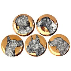 Canine plates by Fornasetti  Italy  1950's  A set of five (5) coaster sized plates depicting an assortment of dog breads. Black and white line art on metallic gold background.