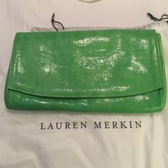 "Lauren Merkin handbag Lime green snake skin. Shiny and gorgeous!  Used once for an event.  10"" X 5.5"".  Clutch style comes with dust bag. Lauren Merkin Bags"