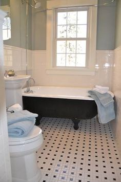 The floor tiles, the wall tiles, claw foot tub... exactly what I would do if I got the house I want:)