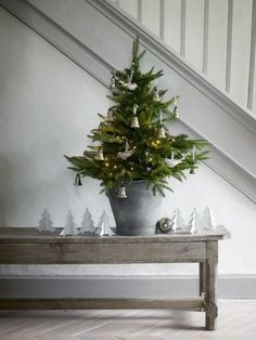 Artificial fir tree as Christmas decoration? A synthetic Christmas Tree or perhaps a real one? Lovers of artificial Christmas decorations , such as Christmas tree or artificial Advent wreath know the Small Christmas Trees, Christmas Tree Design, Noel Christmas, Little Christmas, Country Christmas, All Things Christmas, Winter Christmas, Christmas Hallway, Swedish Christmas