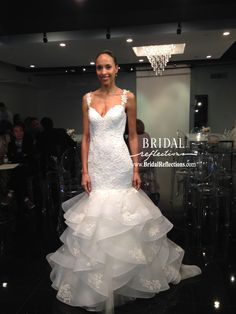 Simone Carvalli Spring 2016 Collection: Every design detail focuses on accentuating the right proportions of curves and effortlessly reflecting elegance, confidence and graceful beauty with fluid movements and floral patterns. http://www.bridalreflections.com/bridal-dress-designers/simone-carvalli