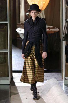 Daniela Gregis. Dang cute...Hat. Skirt print, satiny& sheer. Sweater. Scarf