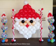 A big balloon Santa head is the best backdrop for a holiday photoshoot! Design…