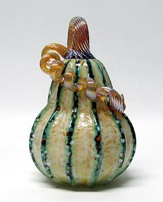 Saffron and Green Stripes Gourd by Ken Hanson and Ingrid Hanson. Blown glass gourd, saffron with green stripes and multi-colored accents. Mosaic Glass, Glass Art, Stained Glass, Glass Pumpkins, Glass Figurines, Gourd Art, Green Stripes, Fall Decor, Sculptures