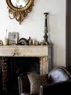 Alex MacArthur Antiques and Interiors- I love the texture of that unfinished fireplace!