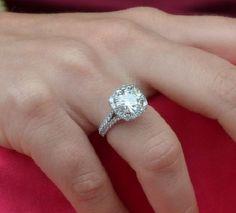 3.5 carat diamond ring on finger