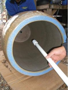 This inexpensive technique makes for a quick and watertight adaptation of glazed pottery into a fountain. Use of PVC standpipe allows plume of water at top and an easy way to drain pot in cold weather.    What You'll Need    Drill  ½˝ Masonry Drill Bit  ¾˝ PVC Female Adapter  ¾˝ Thread x 1˝ Barb Fitting  ¾˝ PVC Pipe  Underwater Epoxy  Circular Saw  Cardboard or Carpet to put under pot while working on it