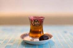 """Special Persian tea in traditional """"Shah Abbasi"""" glass. Photo by: Banu Restaurant. Toronto."""