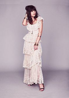 Juliet Lace Dress  Description:  Floral embroidered sheer mesh maxi dress with tiered bottom. Scalloped edges. Sleeves can also be worn off-the-shoulder. Lined. Zips up left side of waist.