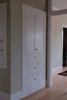 Clean, simple alternative to linen closet: great look for the hall outside bathroom