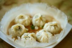 """Pan-fried chive and baby shrimp buns are a specialty from the hometown of Little Ting's owner, Xiaoting """"Ting"""" Guo. (Erika Schultz/The Seattle Times)"""