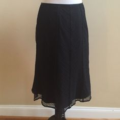 "Skirt ⭐️Black skirt with piping details and a bit of flair at the end⭐️Sheer overlay provides a diagonal pattern⭐️Approximate measurements lying flat are: Length 22 1/2"" & Waist 13""⭐️In good condition⭐️Shell is 100% Nylon⭐️Lining is 100% Acetate⭐️Decoration is 100% Silk⭐️Dry Clean⭐️No TradesNo PayPal Ann Taylor Skirts"