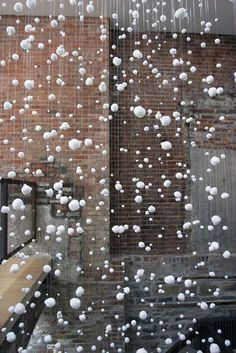 "Office decor ideas ~ OP: Goran Tomcic ""White Pom-poms"" 2005 Installation (fishing line, white pom-poms)"