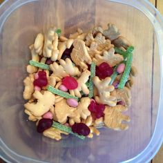 Jungle Snack Mix - animal crackers, strawberry yogurt raisins, fruit shaped fruit snacks and green sour punch straws (vines) - The Jungle Book Movie Night - Disney Movie Night - Family Movie Night