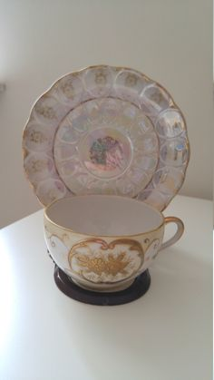 A personal favorite from my Etsy shop https://www.etsy.com/listing/249160090/vintage-iridescent-tea-cup-and-saucer