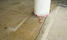 Discover why concrete floors develop cracks and how to repair it for residential garage and basement flooring. Concrete Floor Repair, Repair Cracked Concrete, Concrete Floors, Basement Flooring, Porcelain Tile, Foundation, Garage, Carport Garage, Concrete Floor