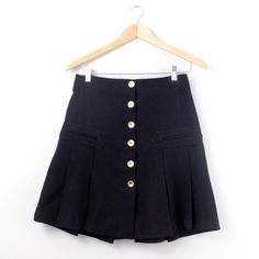 Pleated Six Button Skirt with Faux Pockets Fun and flirty black skirt with six gold buttons (functioning). In excellent used condition. Offers always welcome! Marciano Skirts Midi