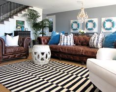 leather couches with a coastal look-proves you dont have to have white fabric covered lounges that are hard to keep clean!