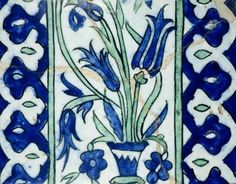 Isnik tile with a vase of flowers and borders (earthenware with coloured underglaze)Turkish School, (17th century)