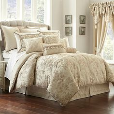 The Waterford Linens Castlequin Comforter Set lets you embrace luxury living with its woven pattern of tonal bouquets on a soft ivory ground. The included bed skirt is embellished with ribbon detail for a charming finishing touch.