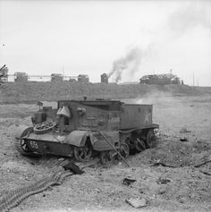 A knocked-out Universal carrier in the factory area of Caen, 19 July 1944.