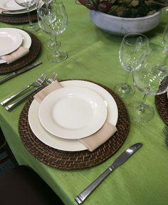 Ivory rimmed china & brown wicker chargers pulled together with a biscotti Panama napkin