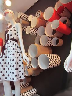 I loved these windows when they were up. Cardboard tubes covered in paper/fabric to create a connection to the product, pattern and movement in a window.Crew windows, New York visual merchandising Visual Merchandising Displays, Visual Display, Display Design, Pop Display, Shop Window Displays, Store Displays, Propaganda Visual, Design Boutique, Vitrine Design