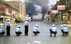 Police deploy across Twelfth Street as buildings burn during the Detroit riots of 1967.  Photo credit: J. Edward Bailey