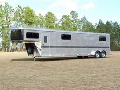 4 horse straight load gooseneck trailer with red and black pin stripes