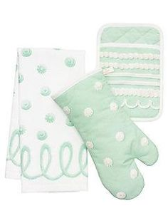 when things get a little heated (as they tend to do in kitchens), keep your cool. this adorable set of oven mitts, pot holder, and dish towel--in a delightfully retro polka dot print--will have your hands out of harm's way through as many rounds of freshly-baked cookies as you can manage.