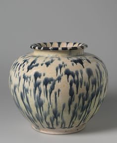 "Ovoid Jar With Short, Flaring Neck And Blue-Splashed Glaze first half 8th century, China - Tang dynasty / 'Sancai' (""three-color"") ware: pinkish white earthenware with lead-fluxed, cobalt-splashed, clear glaze on the exterior, and with lead fluxed yellow glaze on the interior"