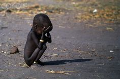 This photograph by Kevin Carter shows a child famine victim in a feeding center.
