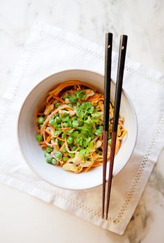Hearty sweet potato noodles meet their match when tossed with a vibrant Thai green curry sauce, peas, and cashews. Source: Sarah Yates for A House in the Hills