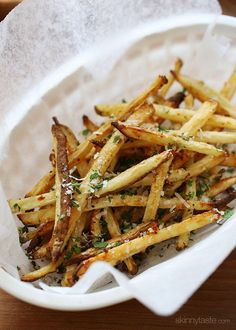 Skinny Garlic Parmesan Fries. Baked in the oven with garlic and oil, then sprinkled with freshly grated Parmesan and parsley – to die for!