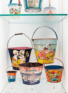 Vintage sand pails xo--FleaingFrance I love these sand pails, they are hard to find and expensive. Very colorful!!