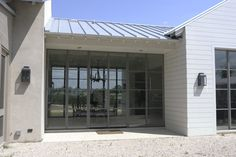 Steel door with windows. Standing seam metal roof. Love everything about this!